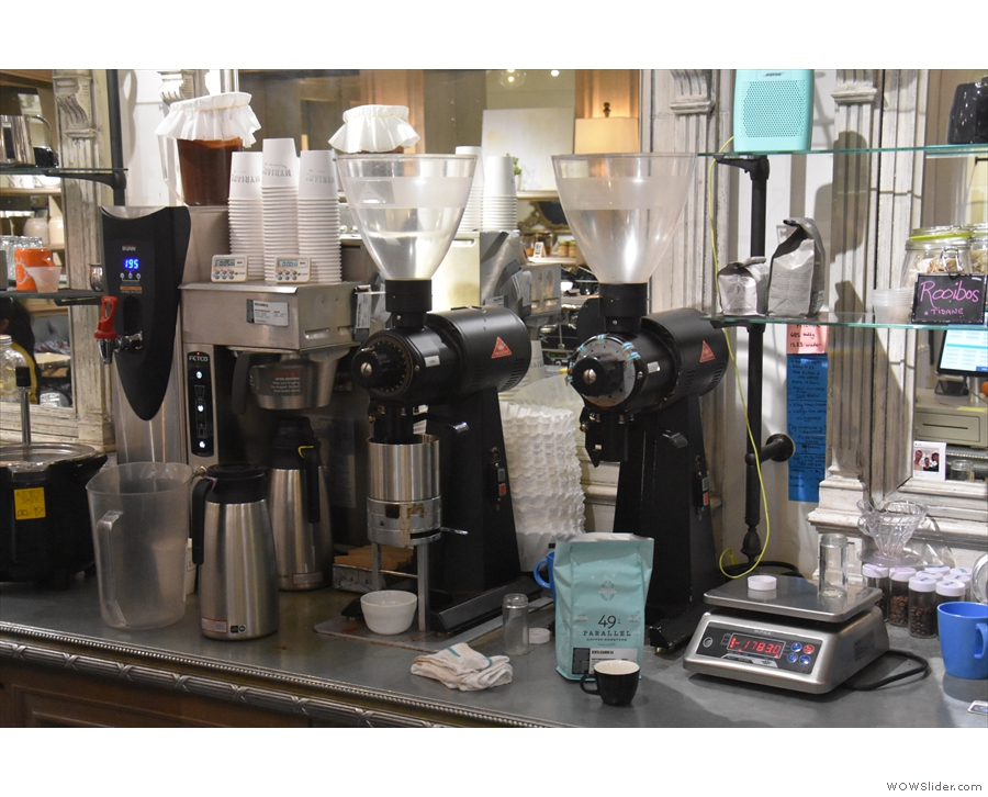 ... while behind the counter is the batch-brewer and a pair of EK-43 grinders.