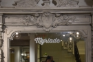 There's a large, beautiful mirror with some gorgeous scroll-work behind the counter.