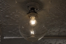... while glass-domed bulbs hang from the ceiling.