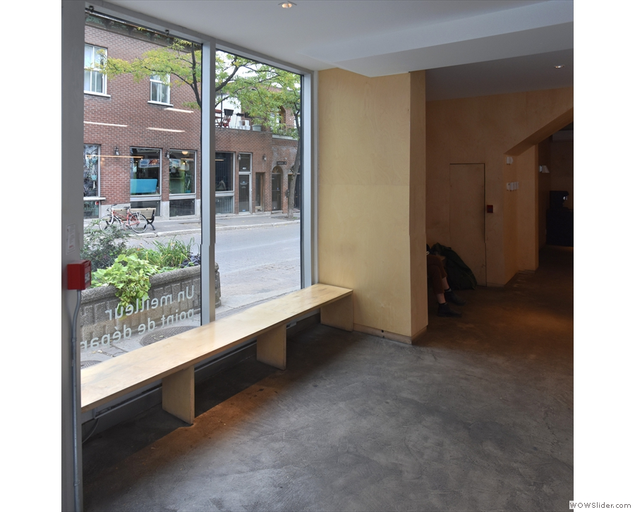 ... including this bench in the window by the door and one on the other side of the pillar.