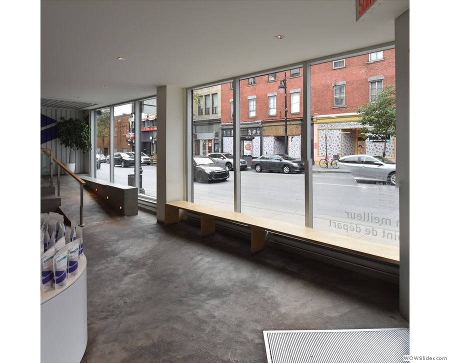 Another broad space is to the right, along the front of the shop, again with a long bench.