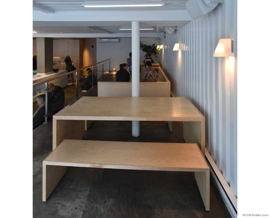 The seating consists of two of these tables, separated by a C-shaped bench.