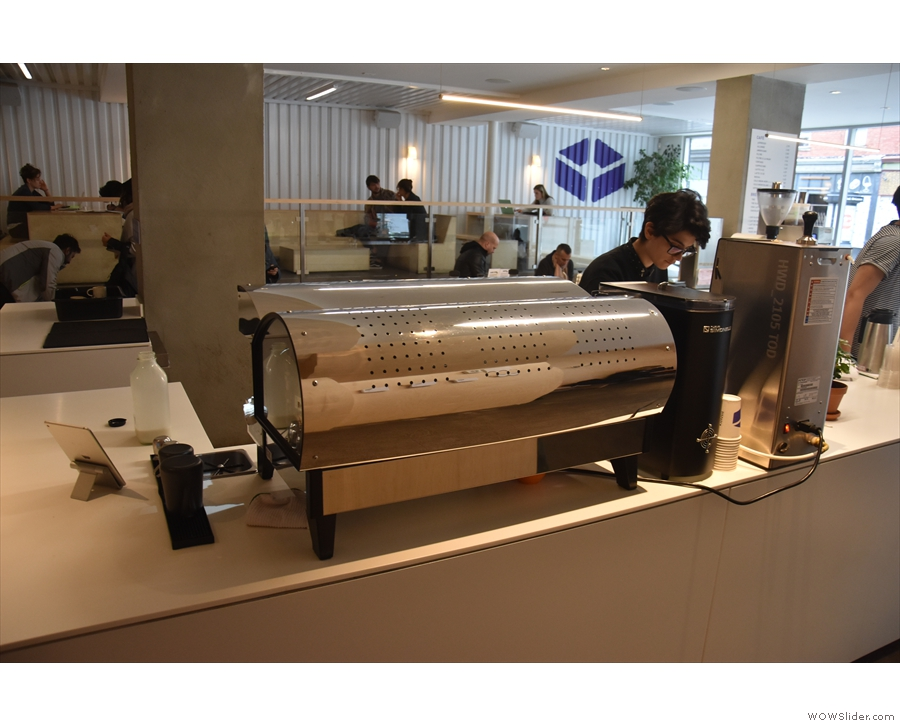 At the far end, past a hot-water boiller, is the espresso machine, a La Marzocco Linea...
