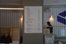 The menu is on a pillar in the middle of the counter.