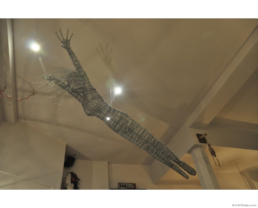 A flying lady hanging from the ceiling. Every coffee shop needs one! It's Bristol's Wild at Heart.