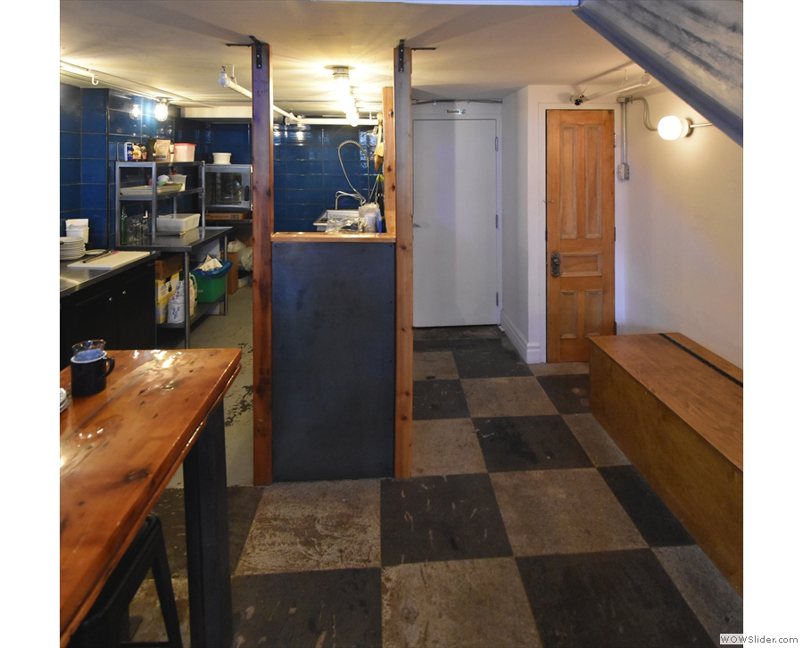 ... at the end of which, tucked away under an extension, are a pair of stools (left) and...