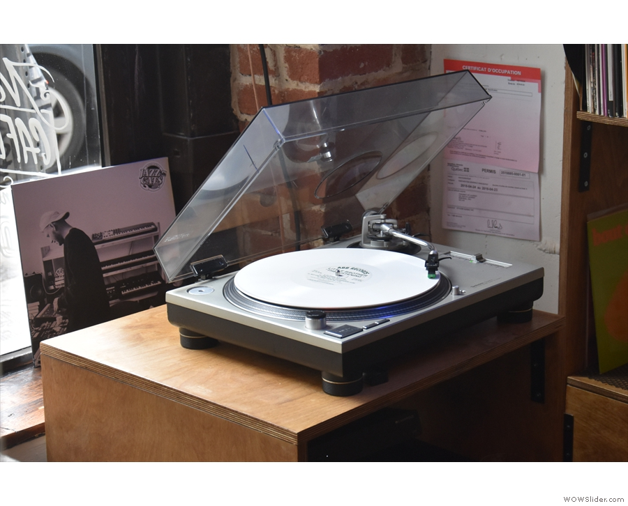 ... which are played on this turntable by the window, the staff choosing the music.