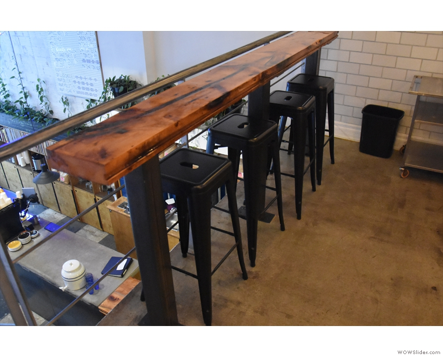 Starting to your left, a four-person bar runs along the front of the mezzanine...