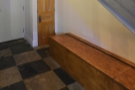 ... to the right, under the stairs, another longer, wider bench.