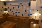 ... while the back wall has multi-colour tiling and a generous helping of power outlets.