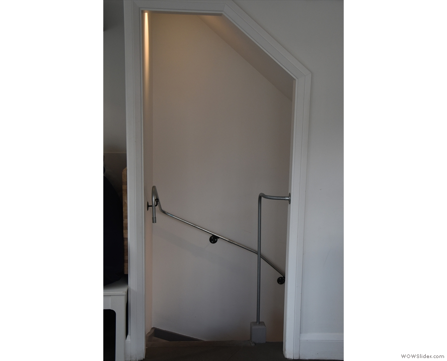 The doorway in the left-hand wall leads down to the toilets in the basement...