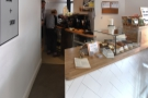 ...behind which is a little niche with the espresso machine. There's a kitchen beyond that.