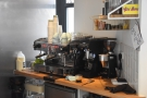 The espresso machine is in this triangular niche behind the counter, serving Ancoats...
