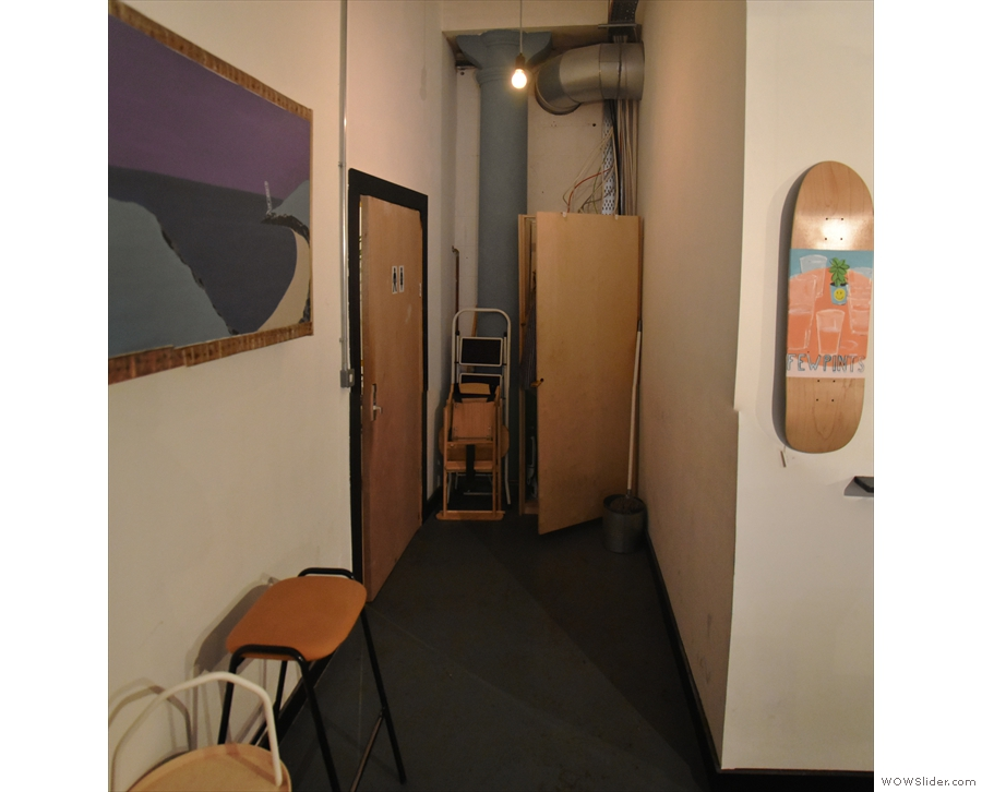 In the back left-hand corner, a short corridor leads to the toilets...