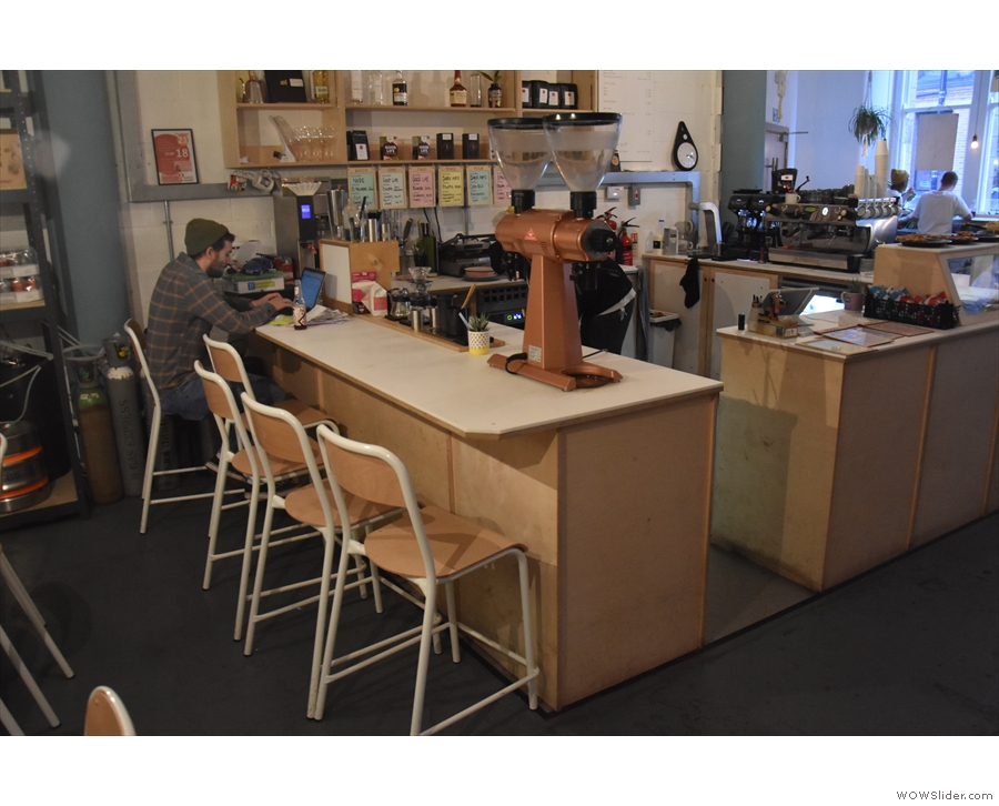 The only other seating is at the back of the counter, where a row of chairs...