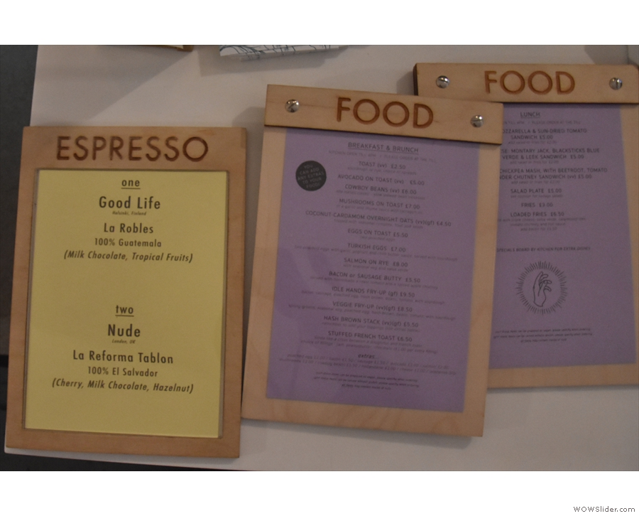 ... with more on the counter by the till. The yellow one has the espresso choices...