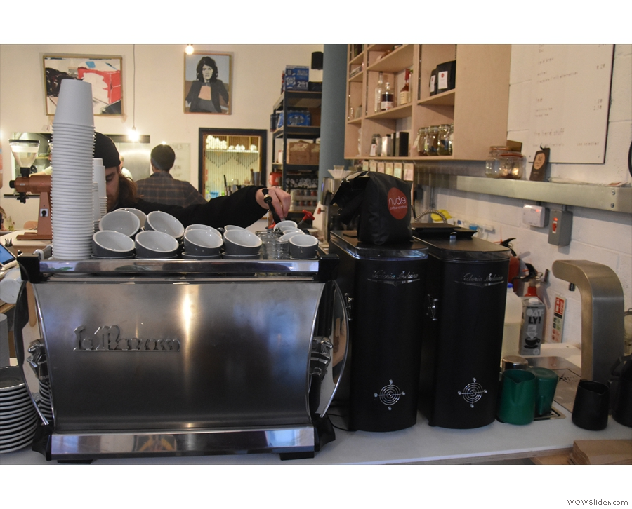 The espresso machine and its grinders greet you as you enter...