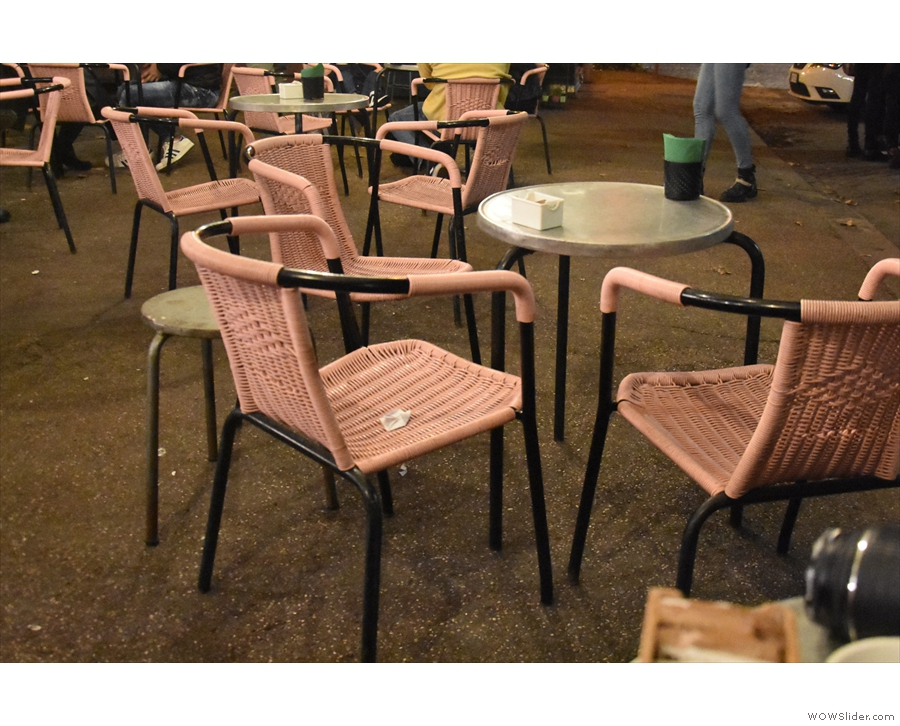 Most of the tables are small, round ones like this, with chairs or stools.