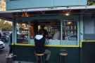 Three of the kiosk's sides have windows. This one faces Via Marmorata. And has stools.
