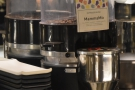... while on the other side of the espresso machine, there's a fourth grinder with the...