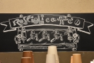 A series of chalk boards behind the counter provide info.. This reminds you where you are.