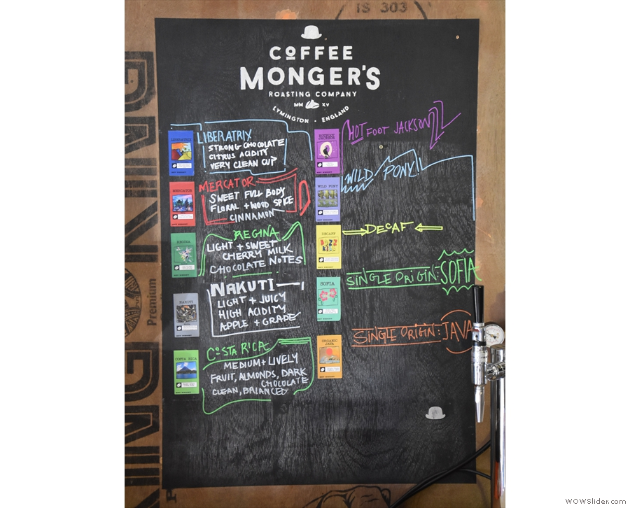 ... with details of the blends and some single-origins to the right of the espresso machine.