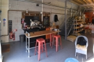 The layout's simple. A counter at the front on the left has the espresso machine...