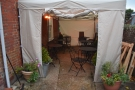 ... it's just sheltering (perhaps only for the winter) in this gazebo at the back.