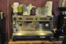 The espresso machine, from 2013, where it was on the wall behind the counter...