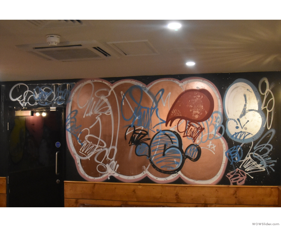 Meanwhile, at the back, there's more graffiti-style art.