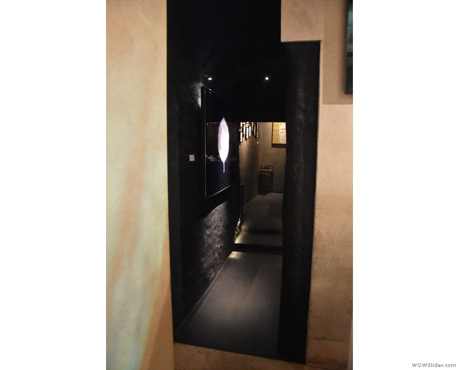 As well as the counter, there's also a back room, which is down a short, narrow corridor...