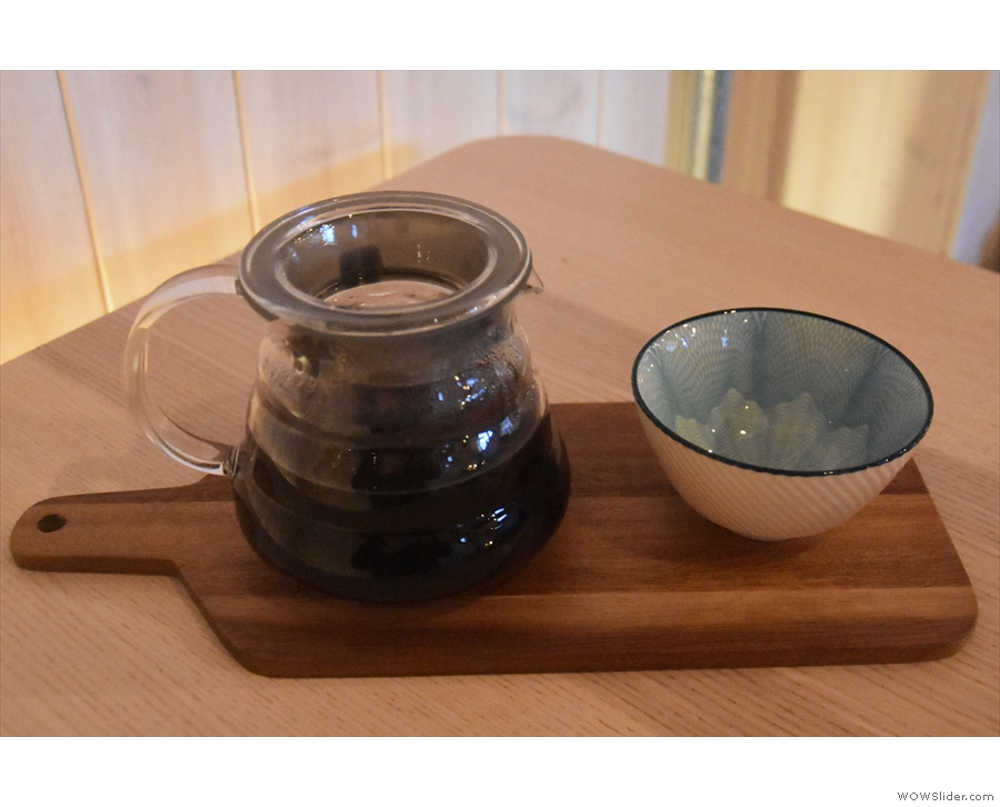 A better shot of my coffee, served on a wooden platter, a gorgeous bowl on the side.