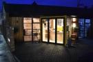 ... Scandinavian Coffee Pod, seen here in the evening. Studio Coffee Roasters is next door.