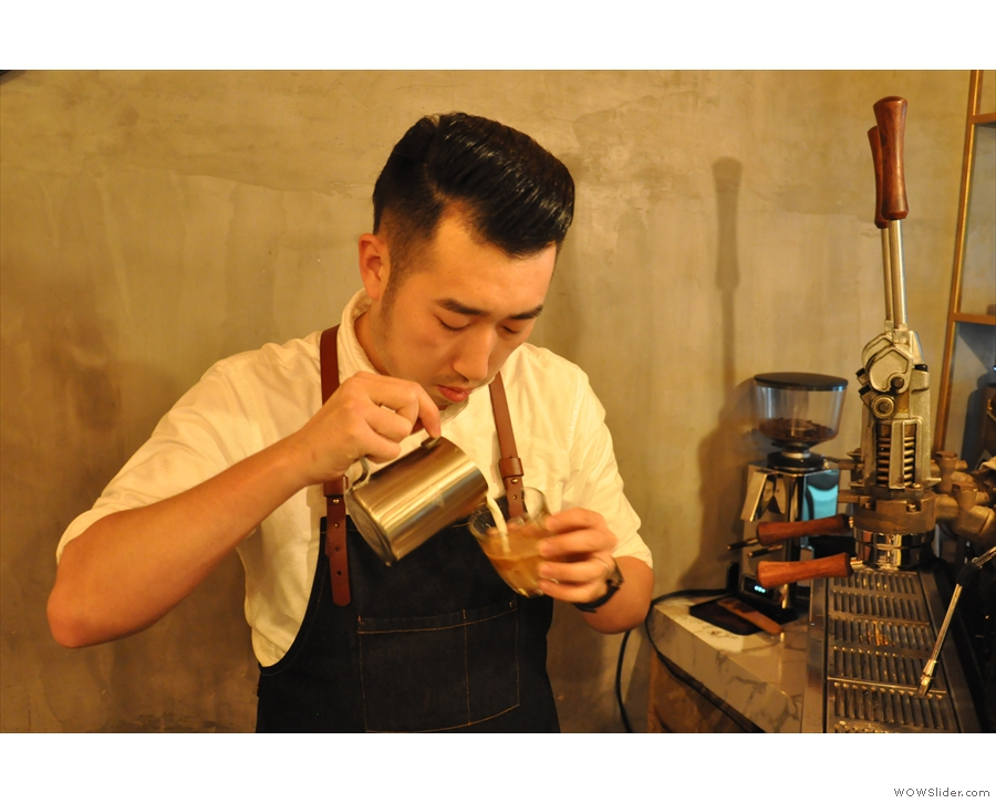 First the barista builds up the base, mixing the milk and the coffee.