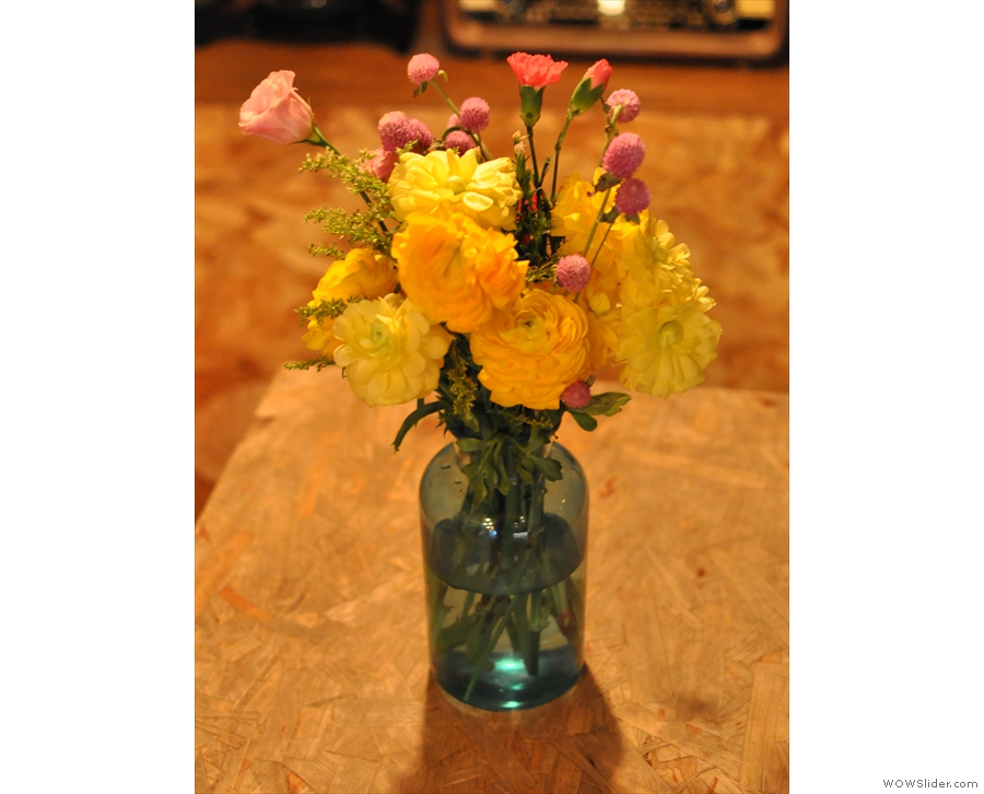 Meanwhile, nice touches abound, such as these pretty flowers on the table...