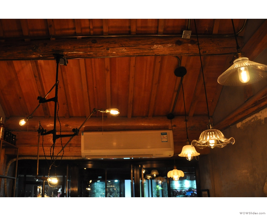 The shaded lights were over the seating, while, on the other side, above the counter...