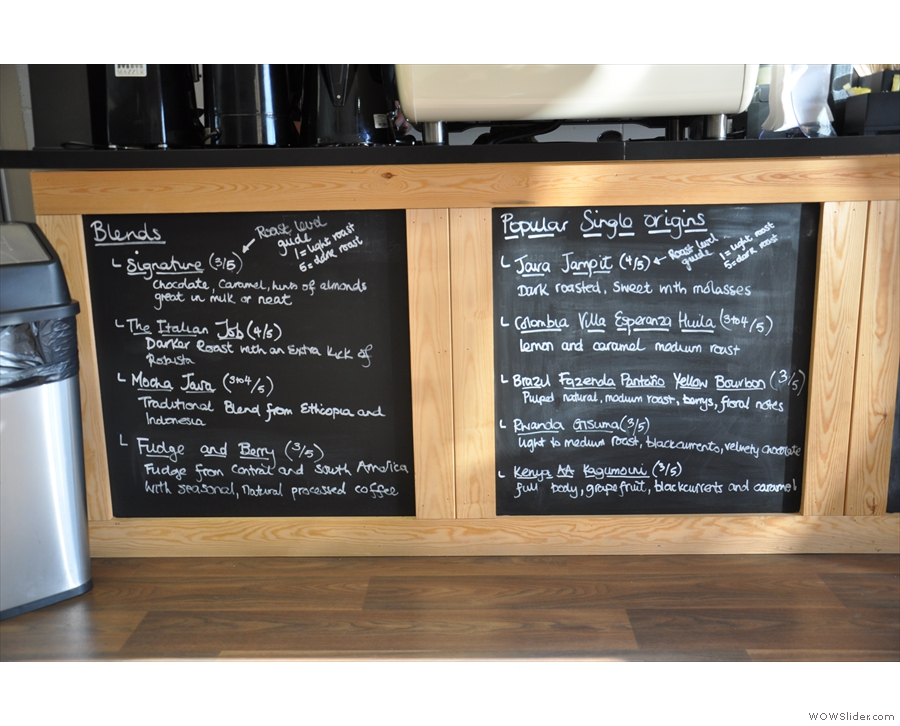 Rave's current coffee offerings (from the roastery) are chalked up on the boards.
