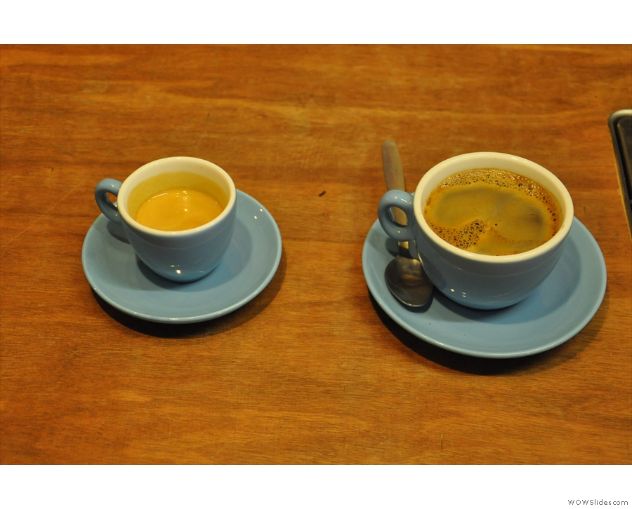 An espresso and an americano being prepared for other customers. I love the blue cups.