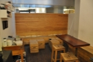 The seating at the back, along with one of the high tables (this was taken after closing time, hence to the lack of customers!)