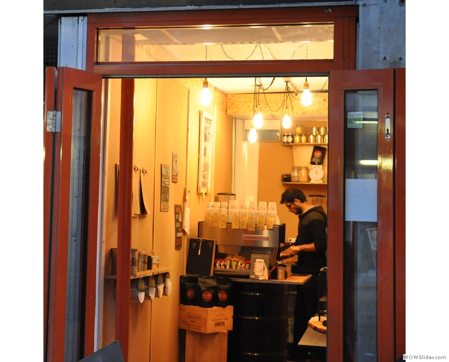 The welcoming interior of Goodge St Espresso as seen from the street.