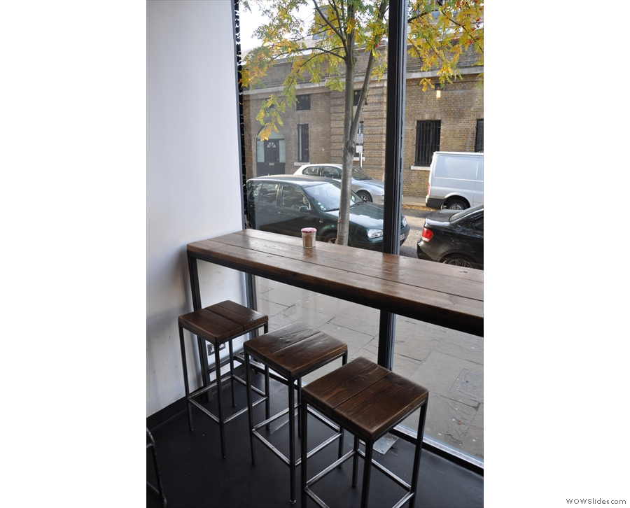The bar seating in the front window.
