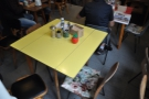 One of the bigger tables is this yellow one that sits in the middle of the room.