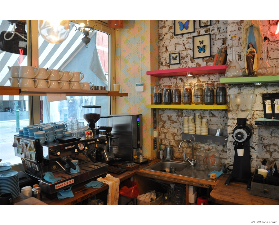 The counter, with espresso machine by the window.