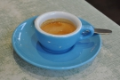 My espresso, in a lovely blue cup and over-sized saucer...