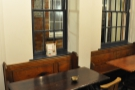 The main seating is in the form of these lovely pews and tables.