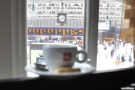 My (blurry) espresso, keeping a sharp eye on the trains for me!