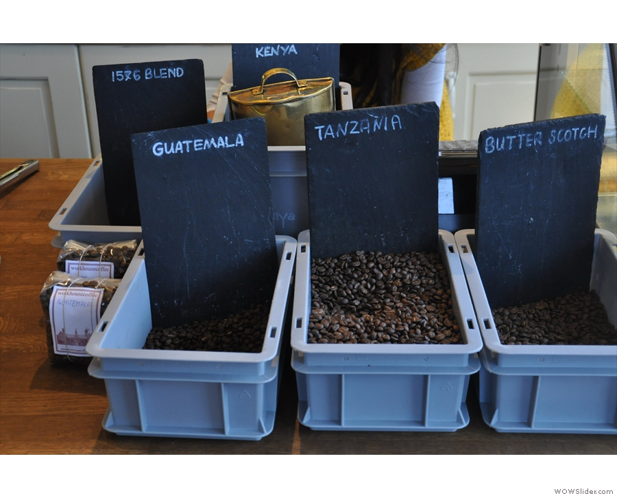 There are coffee beans. For all I've been told about about needing to keep beans airtight and out of the light, Workhouse is happy to have them in open trays...