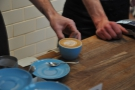 It was busy while I was there. Here a flat white is presented to its saucer.