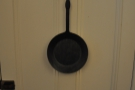 I loved the little touches, such as this pan hanging from a door...