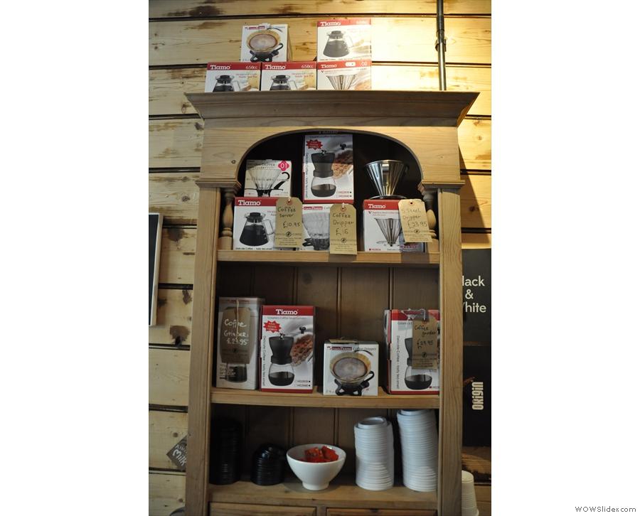 The shelf of coffee-making equipment.